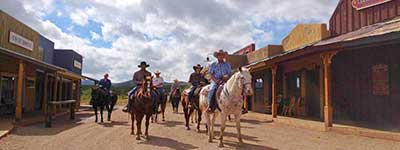 Arizona Dude Ranches -Tombstone Monument Ranch Riding down Main St.